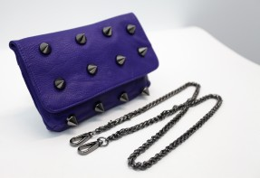 Sign In Blue satchel with huge studs.